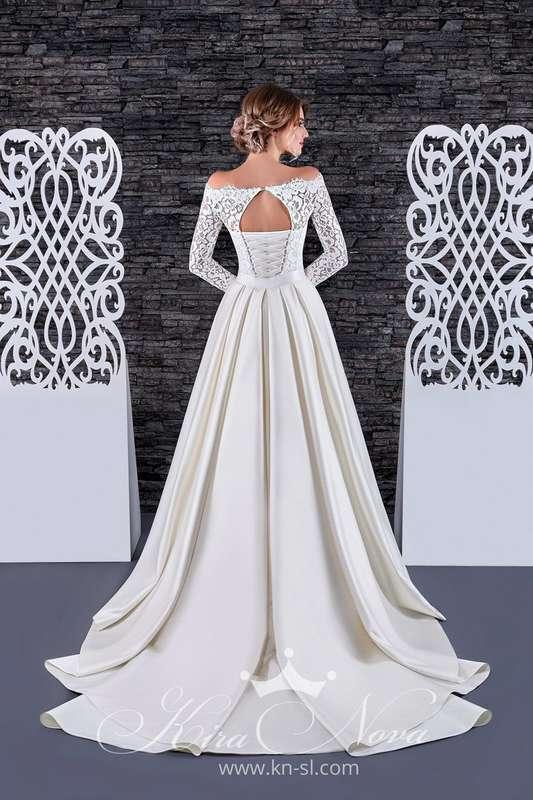 """Свадебное платье - трансформер  Арт. S-08  Восхитительное кружевное платье """"рыбка"""" прекрасно подчеркивает фигуру, съемная юбка из дорогого шикарного атласа декорирована тонким поясом и изящным бантиком. В таком платье вы несомненно будете неотразимы!  Это - фото 16782638 Свадебный салон """"Vesta - Bride"""""""