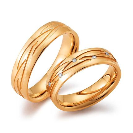 Обручальные кольца из красного золота с узором в виде плетения на заказ