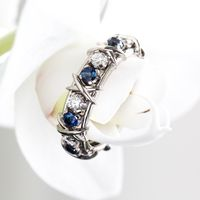Обручальное кольцо с бриллиантами и сапфирами