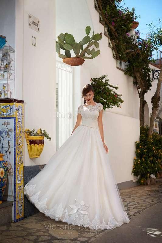 Ornella - фото 13809710 Bondi blue - салон свадебных платьев