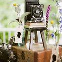 Декор свадьбы старыми фотокамерами.