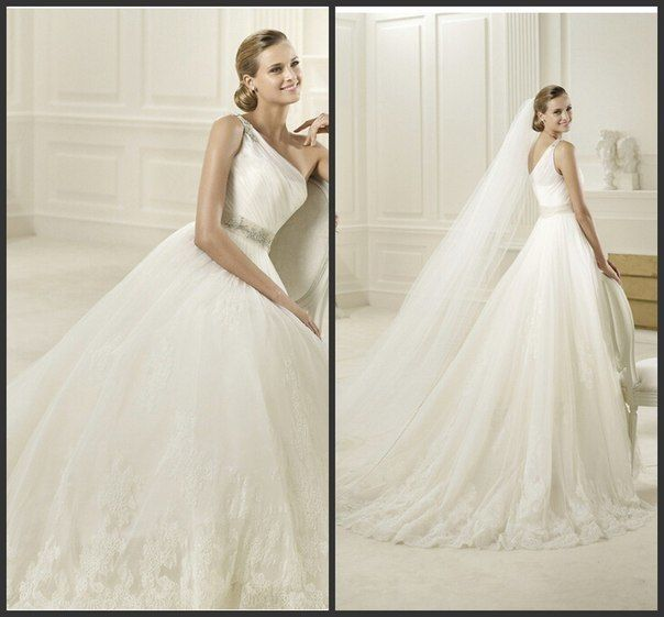 """Свадебное платье """"Diosa"""" с акцентом на одно плече. Роскошное платье низ которого украшен испанским кружевом.  Цвет -айвори.  Размер 46-48 - фото 3505231 Свадебный салон Millennium MOD"""