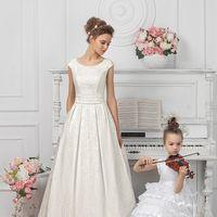 Свадебное платье Богема. Роскошный жаккард подчеркивает изящный крой этой модели А-силуэта.