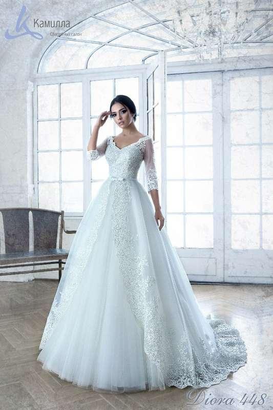 """Роскошная модель Diora - это невероятно стильное, в меру классическое, и по-настоящему современное платье! Благодаря яркой фактуре кружева это платье не требует дополнительных украшений. В таком платье Вы почувствуете себя настоящей королевой! - фото 5985783 Свадебный салон """"Камилла"""""""