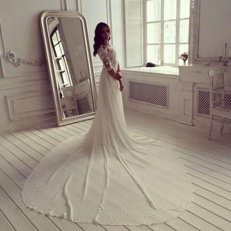 длинный шлейф и кружевной корсет - фото 6377223 Свадебный салон White Rooms