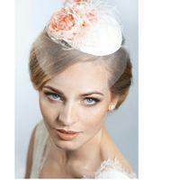 """ШЛЯПКА """" СТЕФАНИ"""" Основа шляпки имеет  круглую форму, декор расположен на одной стороне шляпки . Основа шляпки разработана мной (что позволяет сделать практически любую форму) Обтянута атласом белого  цвета .Небольшая вуаль на глаза из фатина. Декор - ком"""