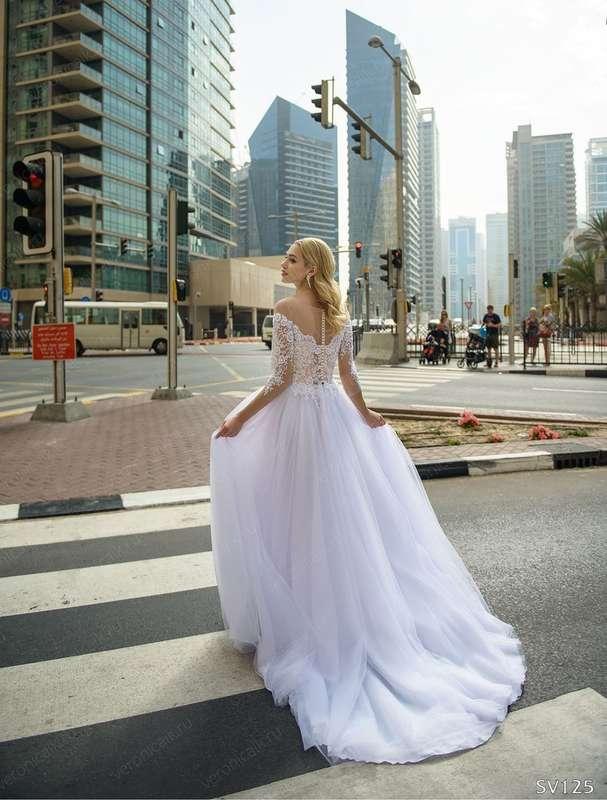 Платье: 125 Возможные цвета: белый Цена: 19900 Вариант покупки: под заказ Оплата: 100% предоплата  Срок исполнения от 1-1,5 месяцев! - фото 17035006 Свадебный салон Feorina