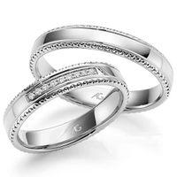 Обручальные кольца из белого золота с бриллиантами. На заказ