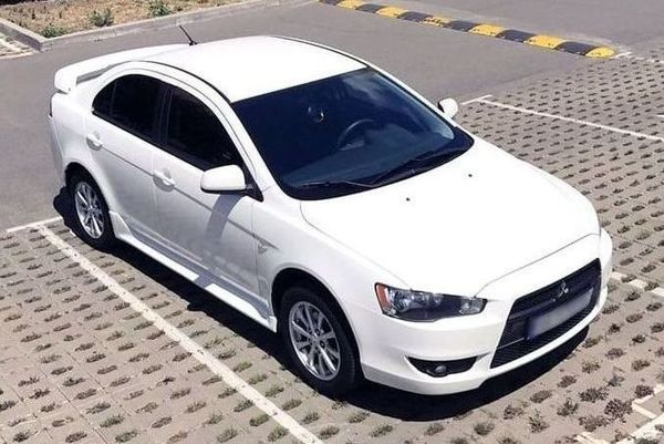 182 Mitsubishi Lancer белый аренда, 4 часа