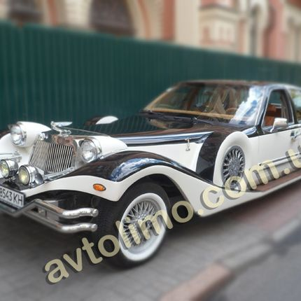 191 Ретро автомобиль Excalibur чёрно-белый в аренду